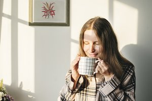 woman drinks coffee in the morning