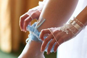 Bride wearing wedding garter