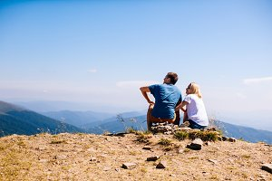 Young couple are admiring the landscape