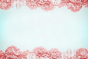 Pastel pink flowers frame on blue