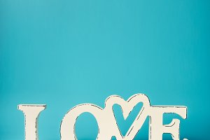 White word LOVE on turquoise blue