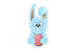 Blue Easter bunny is holding painted and decorated egg. Fluffy rabbit isolated on the white background.
