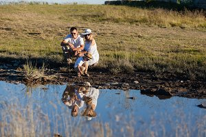 Family walk near the pond