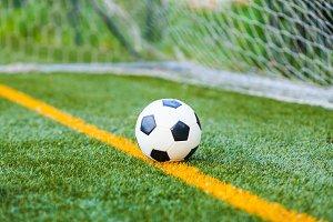 Soccer ball on artificial grass