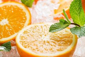 Halves of oranges and ice.