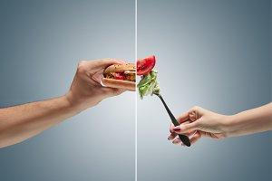 Male hand holding tasty hamburger