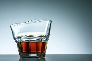 The curved glass of whiskey or alcohol drink