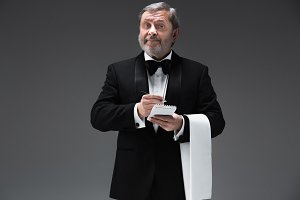 Waiter taking an order wearing a waistcoat in a fancy restaurant