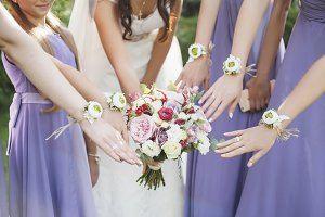 the bride hold a wedding bouquet