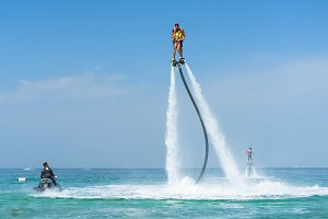 Father ,daughter posing at flyboard