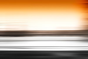 Horizontal black motion blur with orange sky background