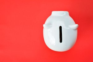 White piggy bank on red
