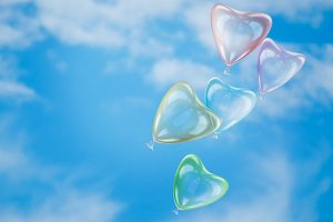 Delicate balloons-heart on blue sky background