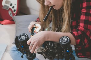 Caucasian teen assemling RC car
