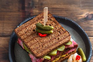 pastrami sandwich with pickle, top view