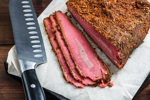 Beef pastrami sliced on wooden board