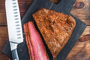 Deli Beef pastrami sliced on wooden board