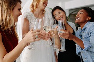 Woman in bridal gown toasting