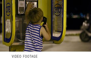 Young boy talking to the phone