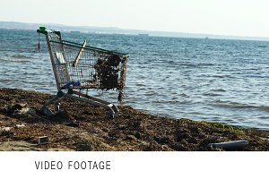 Abandoned shopping trolley on beach