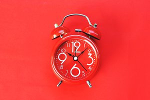 Alarm clock on red