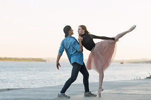 Couple dancing on waterfront of city