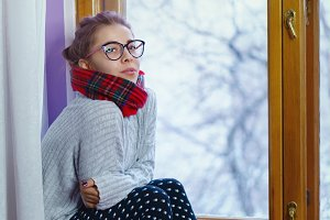 Girl in a scarf and glasses