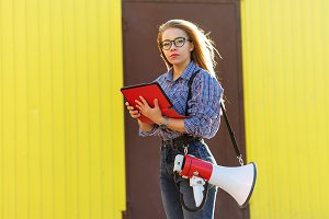 Girl with loudspeaker and tablet pc