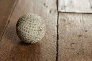 Old Vintage Baseball on wooden