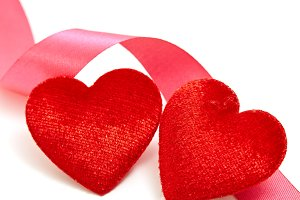 Two red hearts with pink ribbon