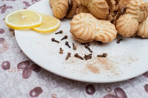 cookies on a plate with condensed milk with lemons under a coffee