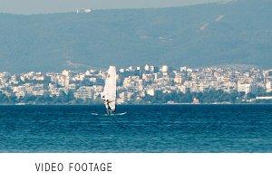 Person sailboarding offshore