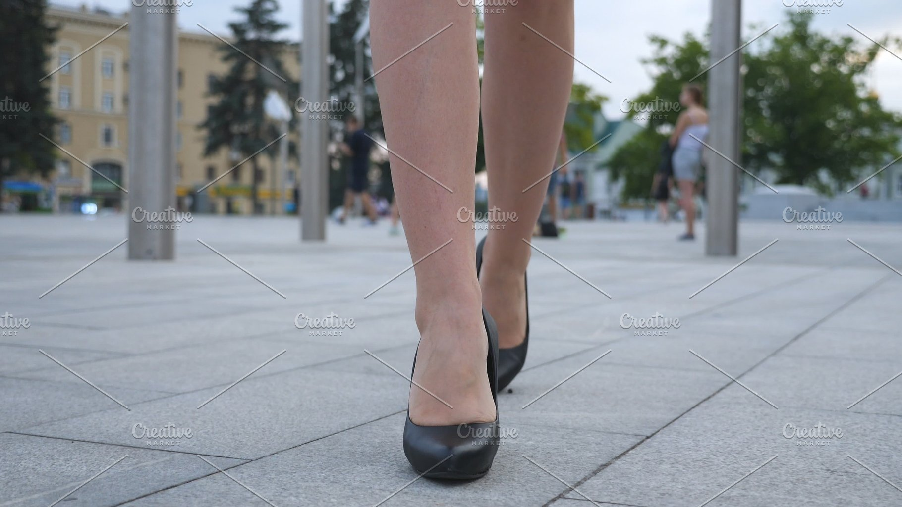 d09cb3e10fb Feet of young business woman in high-heeled footwear going in the ...
