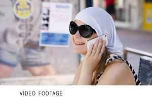 Woman in a headscarf chatting mobile