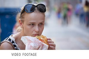 Young woman eating.