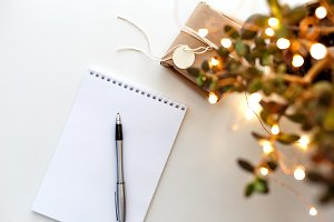 notebook on the table with a garland