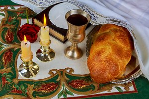 Shabbat eve table with challah bread