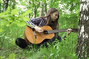 Girl playing the guitar.