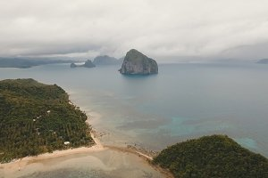 The beautiful bay with mountains rocks aerial view. Tropical islands.