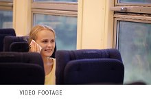Woman talking on the phone in train