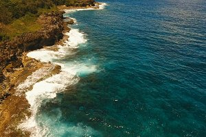 Aerial view of the cliffs and wave. Philippines,Siargao.