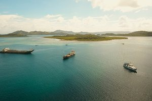 Aerial Cargo and passenger ships in the sea. Philippines, Siargao.