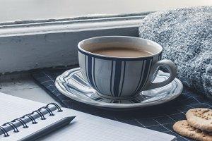 Coffee cup on the windowsill