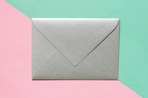 Silver envelope on pink green paper