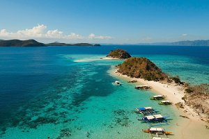 Aerial view beautiful beach on a tropical Bulog Dos Island. Philippines.