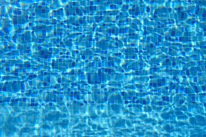 Blue water in pool. Beautiful background. Slow motion Close up