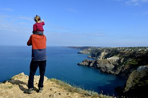 a man with a child on the edge of th