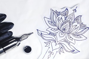 tattoo gun, stamp and some ink for tattoo.