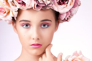 Closeup beauty portrait with flowers