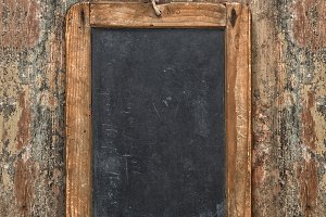 Antique chalkboard on wooden texture